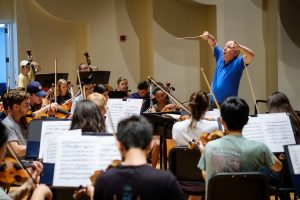 Wake Forest music professor David Hagy conducts the orchestra in rehearsal in Brendle Recital Hall on Monday, September 16, 2019.
