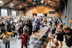 Wake Forest students host local elementary school students for trick-or-treating during the annual Project Pumpkin service project, held this year in the Sutton Center gymnasium on Wednesday, October 30, 2019.