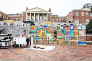 Students and faculty commemorate the 30th anniversary of the falling of the Berlin Wall by hosting a graffiti contest and their own destroying of the wall on Friday, October 25, 2019.