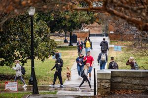 Wake Forest students walk through a sudden shower on their way to class on the first day of the Spring 2020 semester, on the campus of Wake Forest University, Monday, January 13, 2020.