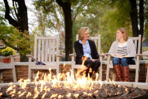 Wake Forest business professor Cynthia Tessien, left, talks with senior Noelle Van Calcar ('17) near the fire pit outside Farrell Hall on Tuesday, November 8, 2016.