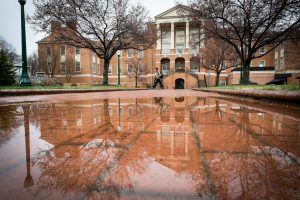 Students walk across Tribble Plaza on a rainy early spring day on Tuesday, March 25, 2014.