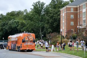 Wake Forest students line up to take selfies in front of the ESPN College Gameday tour bus on north campus, on Thursday, September 10, 2020. College Gameday will broadcast from Truist Field on Saturday.