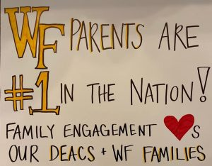 Office of Family Engagement's sign for College Gameday