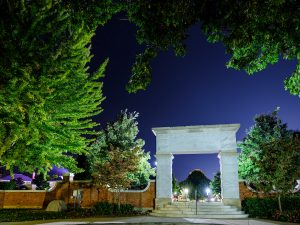 The archway leading to Hearn Plaza is lit at night, on the campus of Wake Forest University, Wednesday, October 7, 2020.