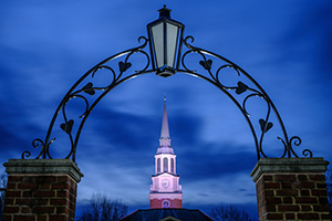 Wait Chapel is framed by an ironwork arch in the predawn light, on the campus of Wake Forest University, Friday, February 14, 2020.