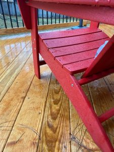 ice has melted from the adirondack chair