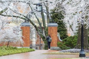 student taking picture of icy campus- photo by riley herriman '22