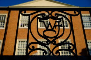 WF ironwork decorates a railing in front of Reynolda Hall, on the campus of Wake Forest University, Friday, April 16, 2021.