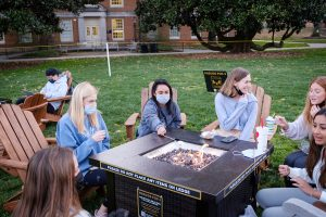 Wake Forest students make s'mores around the fire pits on Manchester Plaza as they wait for the Student Union Open Mic to begin, on the campus of Wake Forest University, Monday, March 29, 2021.