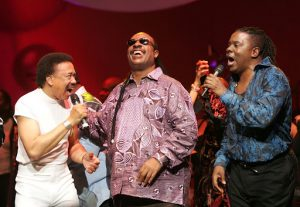 "LOS ANGELES - DECEMBER 11: Singer Stevie Wonder (C) and Maurice White (L) and Philip Bailey (R) of the band Earth, Wind and Fire performs during the inaugural ""Grammy Jam Fest"" at the Wiltern Theatre December 11, 2004 in Los Angeles, California. The event celebrated the music of Earth, Wind and Fire and raised funds for various arts charities. (Photo by Carlo Allegri/Getty Images)"