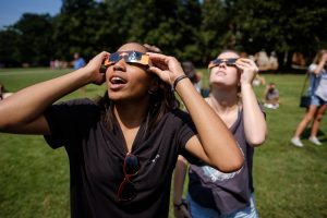 First year students in the Worldwide Wake pre-orientation program watch a near-total eclipse of the sun from the Magnolia Quad on the Wake Forest campus on Monday, August 21, 2017. Indy Cousin, '21, from Kansas City, reacts as she sees the eclipse.