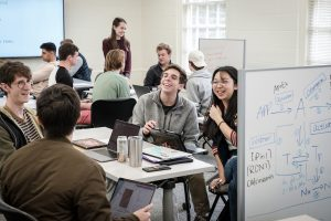 Students in Computer Science 112 with professor Sarra Alqahtani work in small groups to write code in the C++ programming language, in Manchester Hall on Thursday, March 5, 2020.