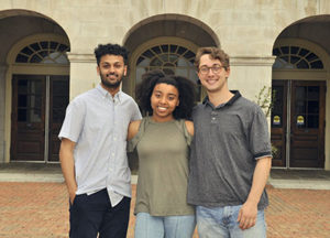 Three students standing in front of Reynolda Hall at WFU