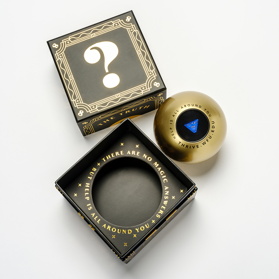 Photograph of the Magic 8 Ball and box that Wake Forest is giving to first year students, in the studio on Wednesday, February 26, 2020.