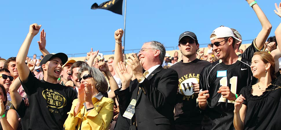 Dr. Hatch and Julie join the students in cheering on the Demon Deacons.