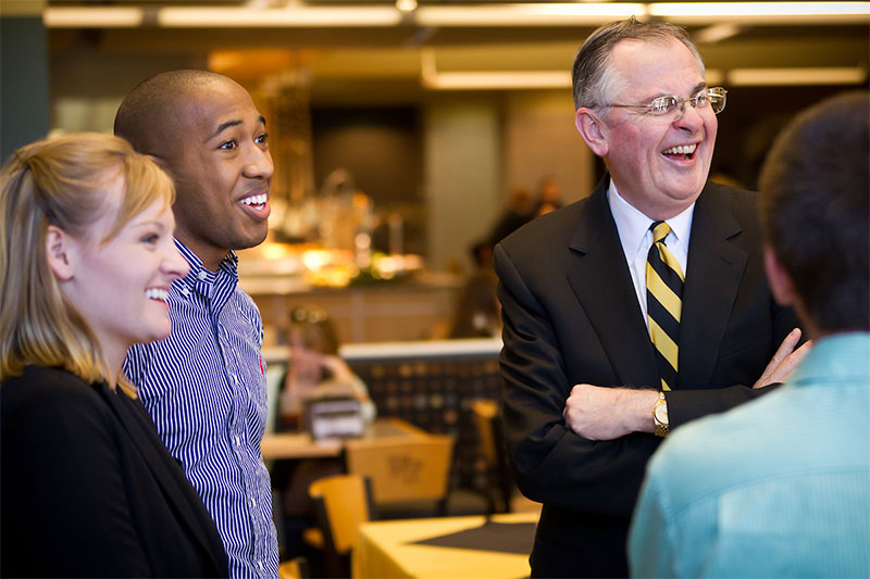 Wake Forest President Nathan O. Hatch talks with several Presidents Aides in the Reynolda Fresh Food company.