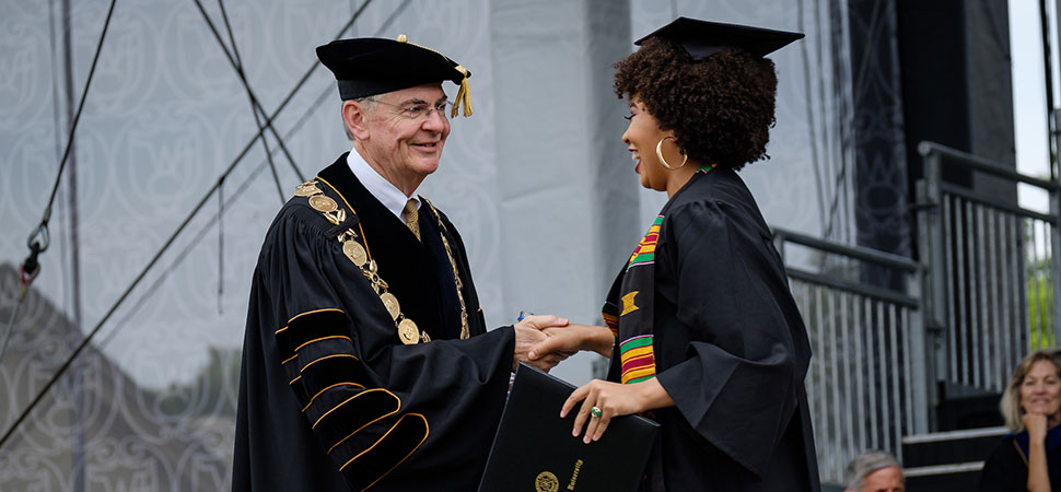 President Hatch congratulates a graduate during commencement
