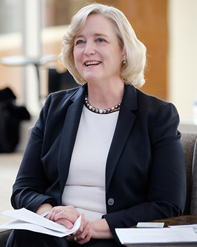 Dr. Susan R. Wente holds papers while looking at a video screen.