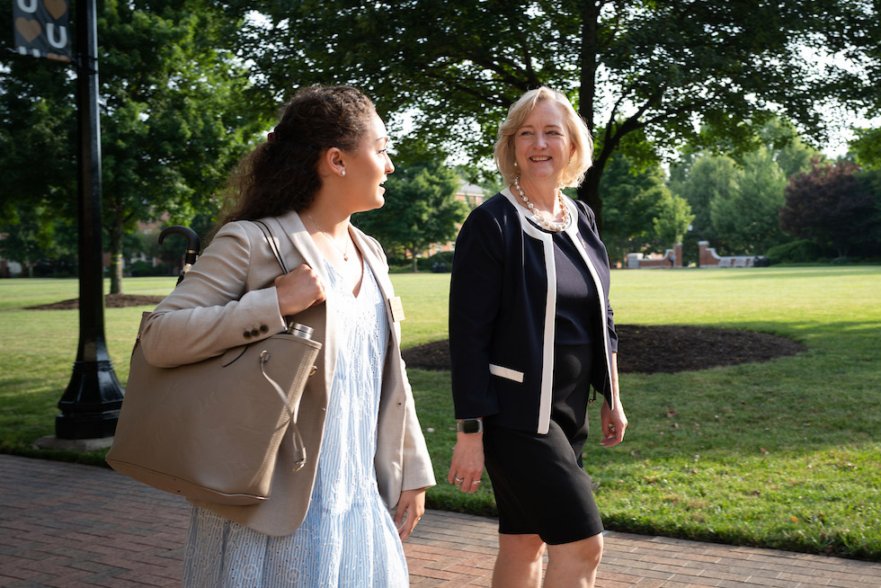 President Wente walks the Quad and talks with Mary Logan Costanza ('21)