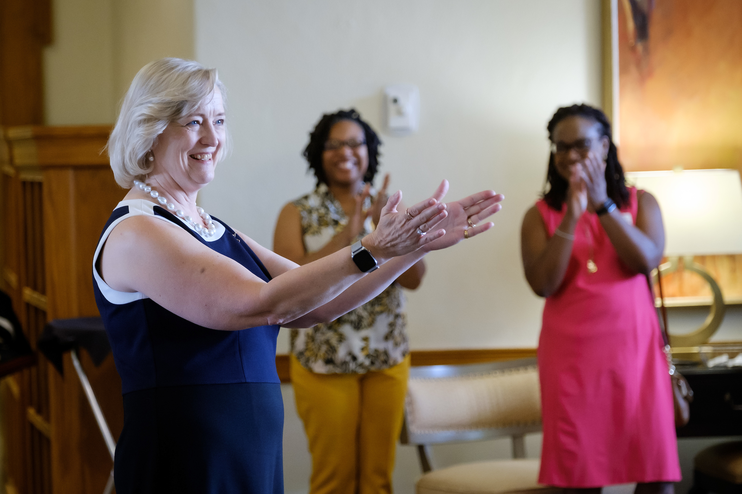 President Susan Wente gestures will speaking to a group of administrators.
