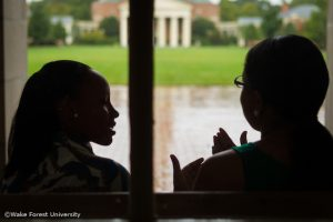 Two students talking in Reynolda Hall