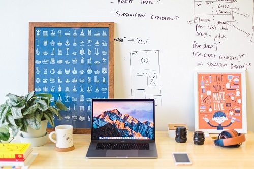 Desk with laptop, whiteboard, and other desk items