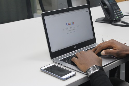 Man using Google on laptop