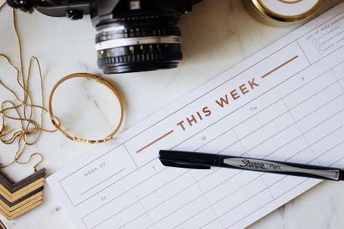 "Image of pen and a calendar/to-do list that says ""This Week"""