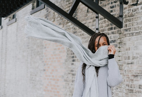 Woman hiding face with scarf