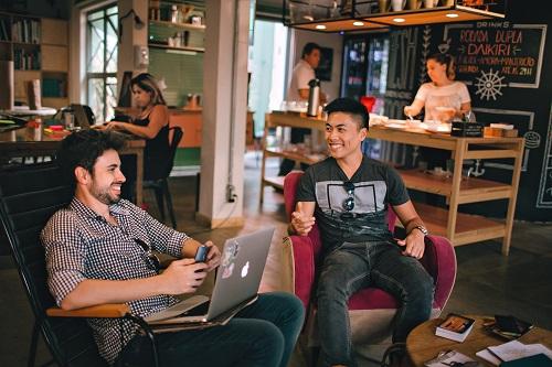 Two men talking in a coffee shop