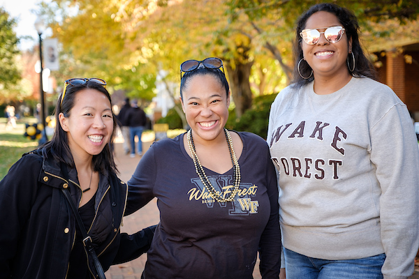 Three Wake Forest alumnae on the quad at homecoming event