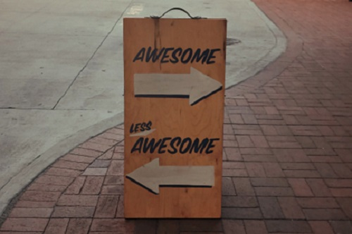 "Sign that says ""Awesome"" (pointing to the right) and ""Less Awesome"" (pointing to the left)"