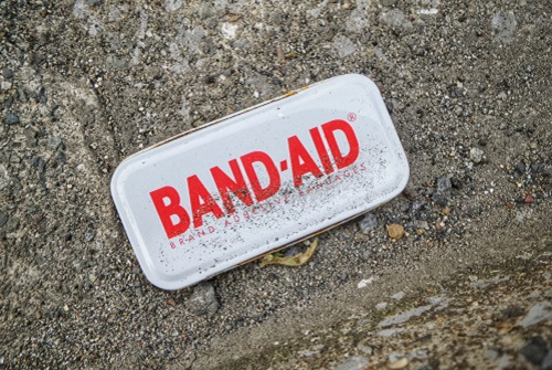 Band-aid container on the ground
