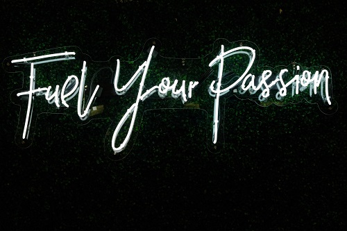 Neon light that says Fuel Your Passion