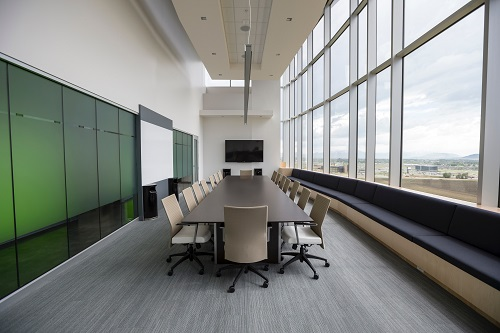 Conference room with table and chairs, empty