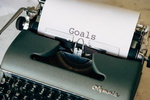 "Typewriter with the word ""GOALS"" on paper"