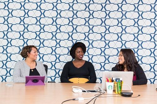 Three women talking at a table