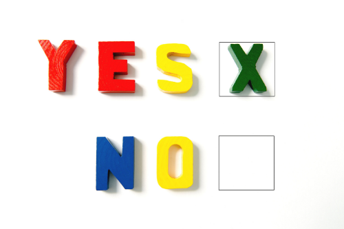 "Letters spelling out ""Yes"" and ""No"" with checkboxes next to them"
