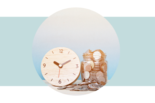 Clock with a glass jar of coins next to it