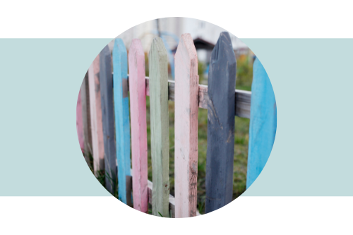 Picket fence painted in multi-colors.