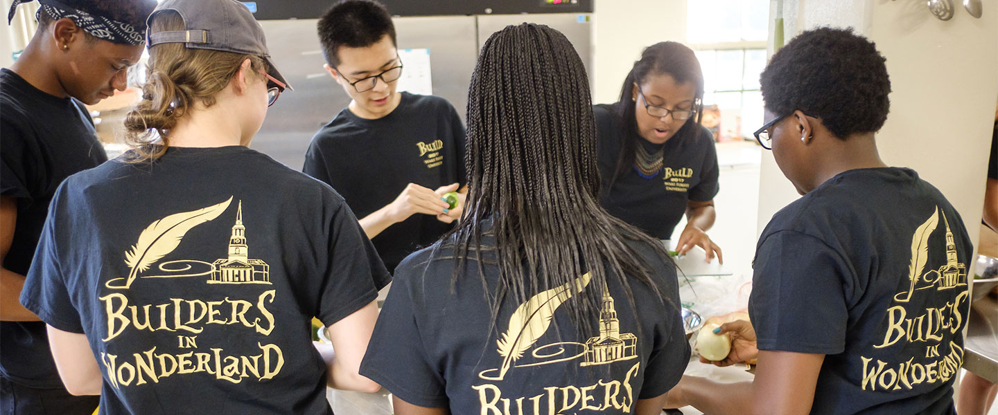 New Wake Forest students in the BUILD pre-orientation program prepare a communal pot luck dinner in the Campus Kitchen space