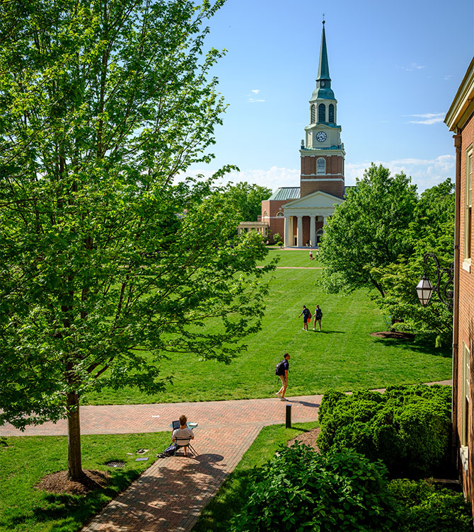 Wake Forest students study and hang out on Hearn Plaza on a beautiful spring afternoon