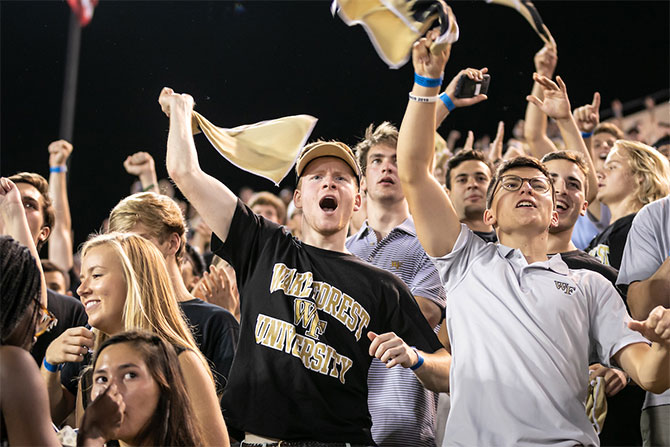 Students cheering on the Demon Deacons