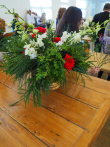 winter arrangement with red flowers