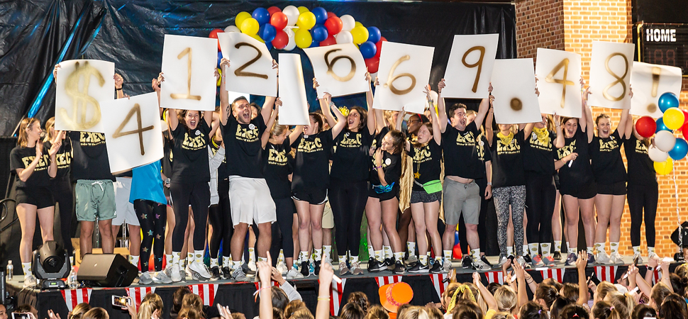 Students reveal $412,669.48 fundraising total at the 2019 Wake 'N Shake event.