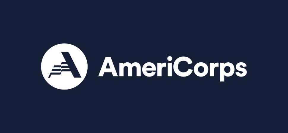 AmeriCorps logo on navy blue background