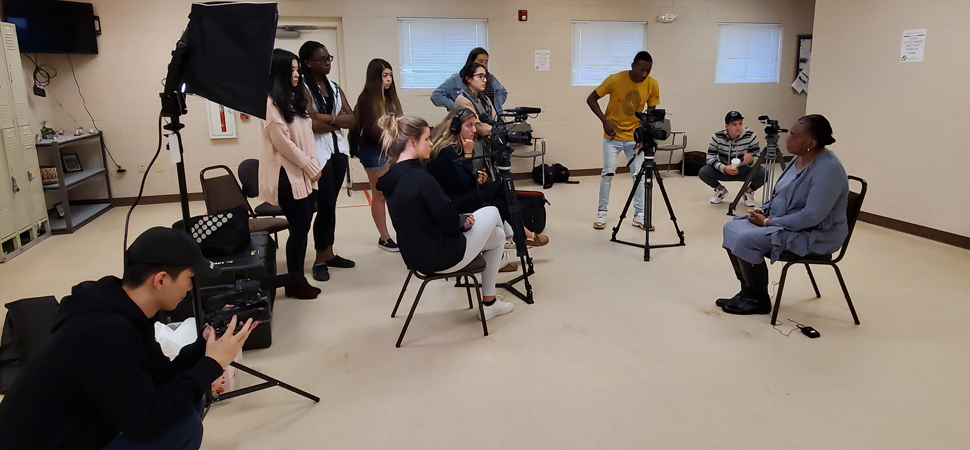 Students in Thom Southerlands 2019 Media Production course interview a staff member at The Bethesda Center for the Homeless for his documentary, Bethesda: A Shelter's Story