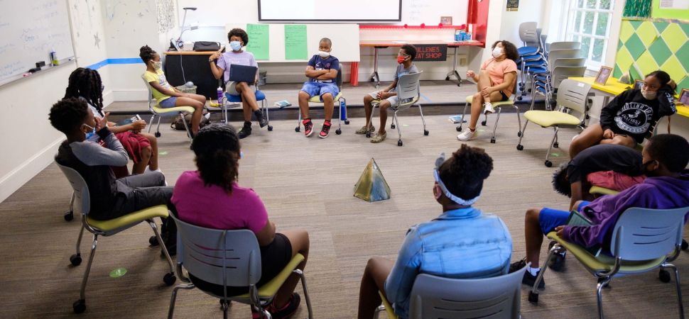 Freedom School scholars listen as teacher Sierra DeVeaux, a Wake Forest rising senior and sociology major, reads to them.
