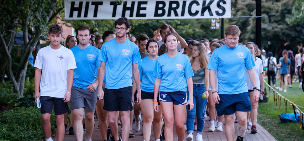 Students walk the final, silent lap at the 2021 Hit The Bricks.